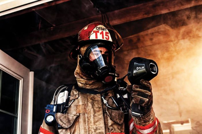 firefighter with flir thermal imager